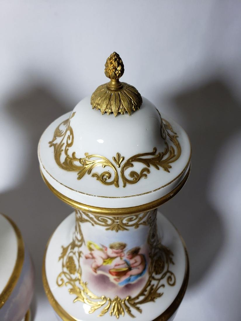Pr of 19th c Sevres urns signed with cherubs - 6