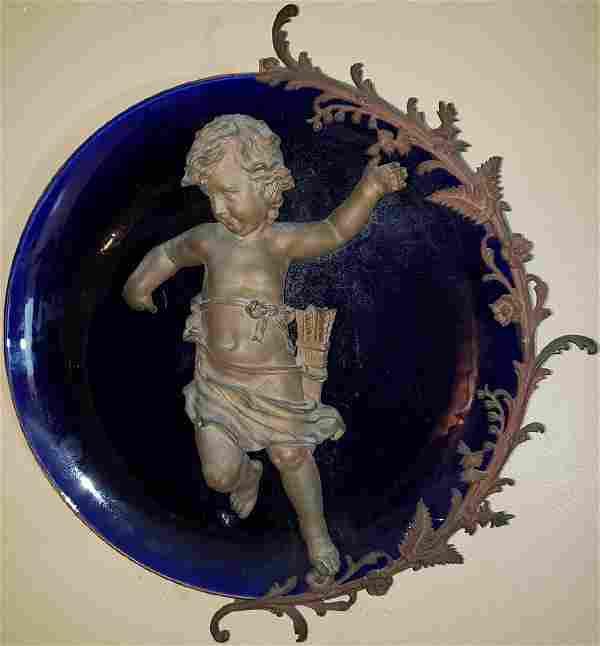 Antique cobalt blue charger w/ mounted spelter cherub