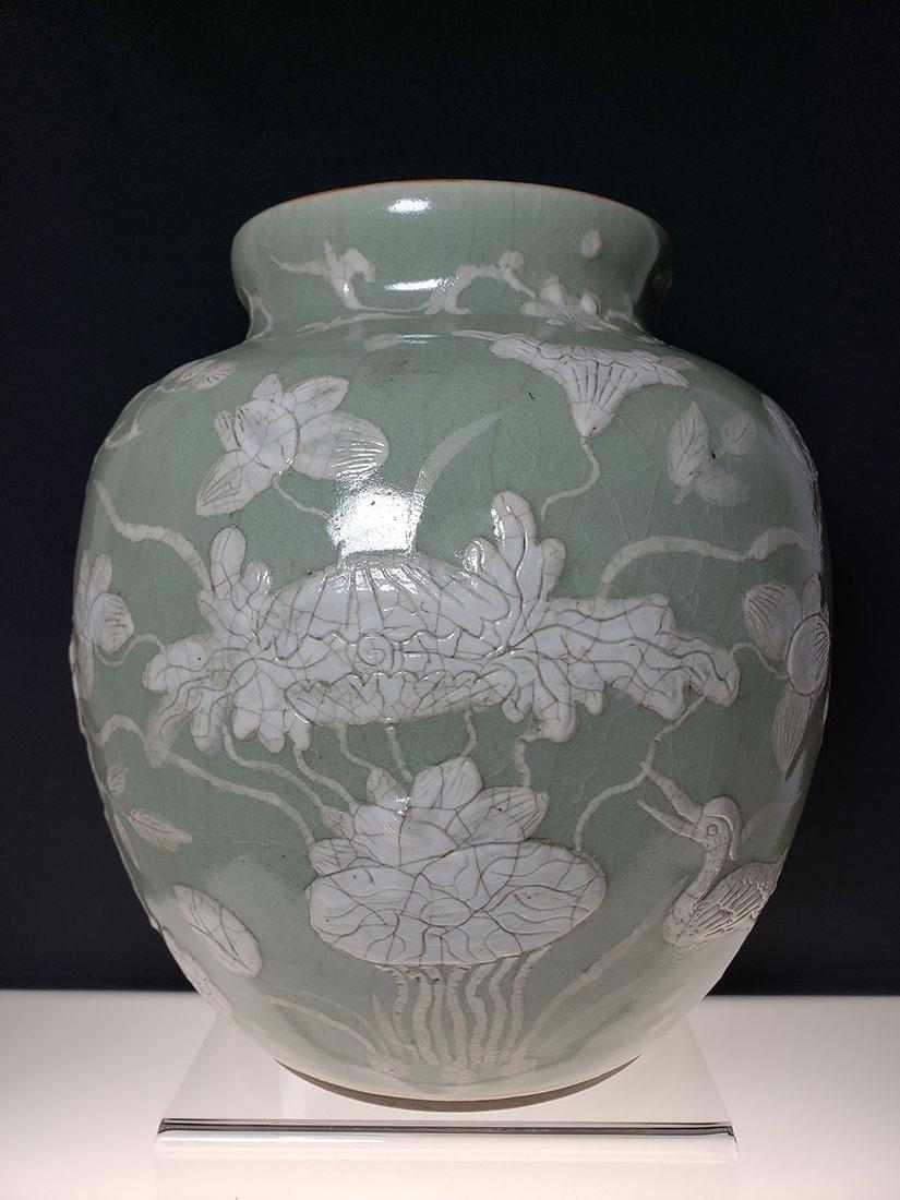 A fine Chinese slip glazed decorated celadon vase 19 c