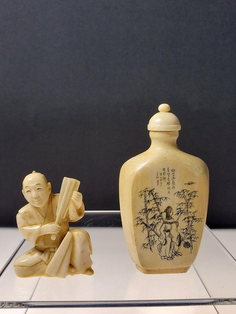 OLD Chinese snuff bottle with marks and a figure