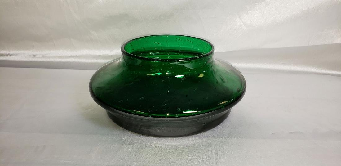 A heavy hand blown glass bowl with mark