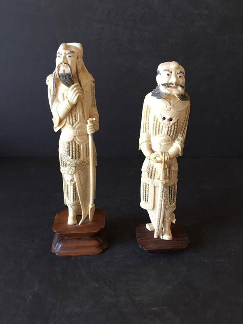 Pr of finely carved Chinese figures