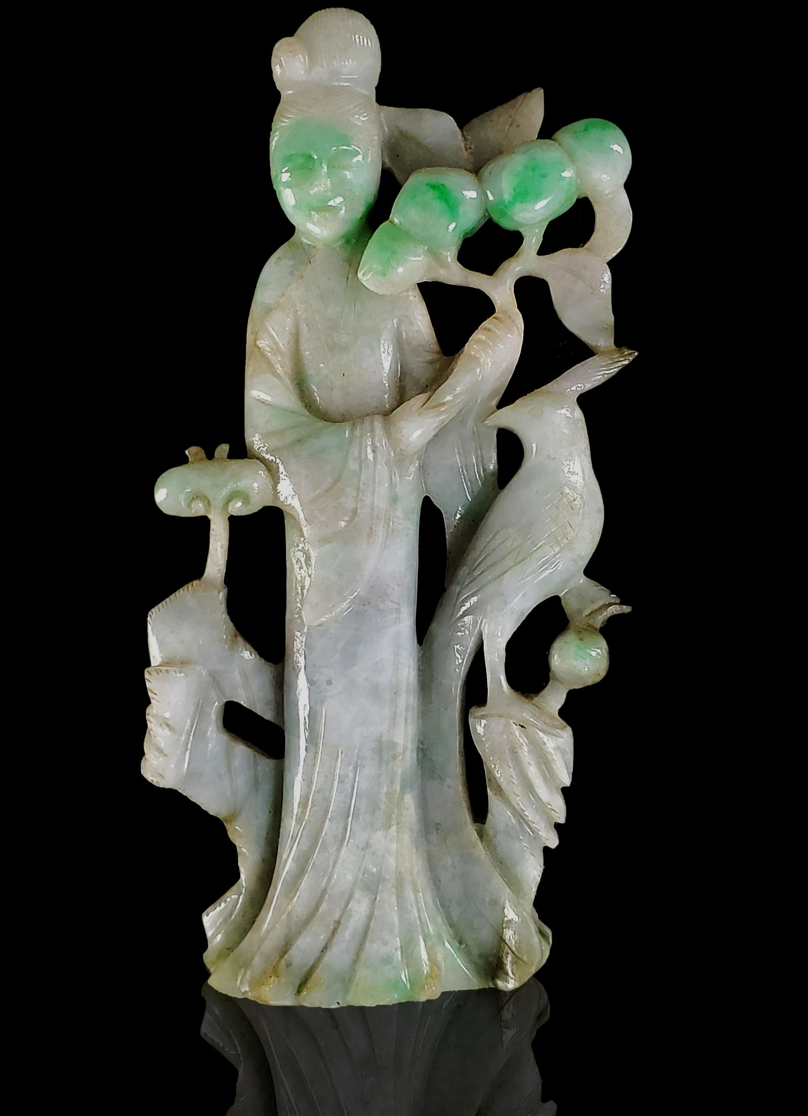 A Chinese carved jade figure of Kwan Yin
