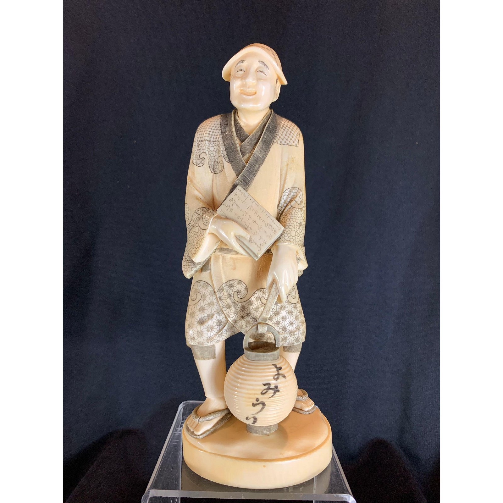 Antique carved man holding lantern