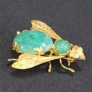 "18k gold and jade brooch 1.4"" long. Weighs 8.6 grams"