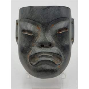 A Carved Jade Mask Age Unknown