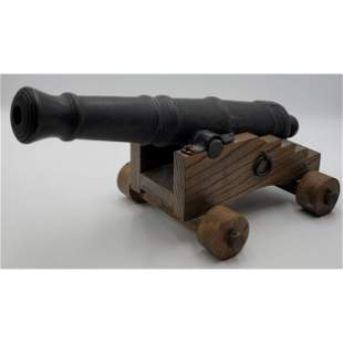 A Large Cannon On Wood Stand