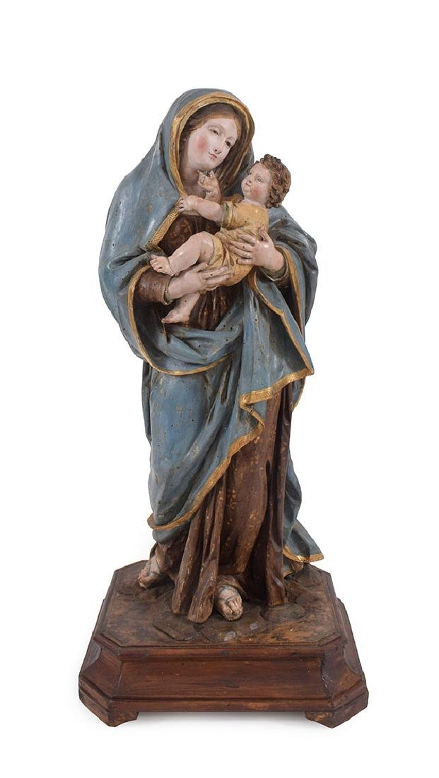 A polychrome wood sculpture of the Virgin and Child