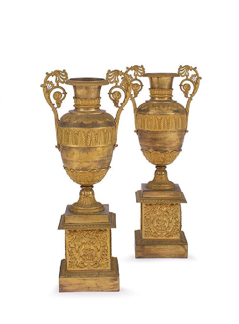 A  pair of French ormolu amphoras, circa 1830