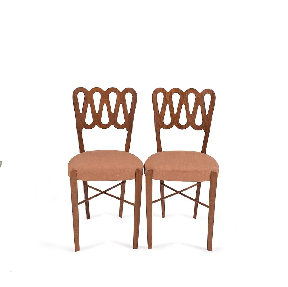 A pair of walnut armchairs, Gio Ponti for Montina, 80's