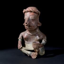 A pre-Columbian terracotta sitting coca chewer