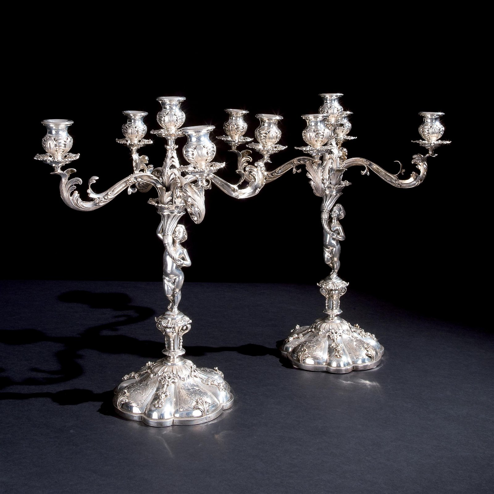A pair of silver five-light candelabra