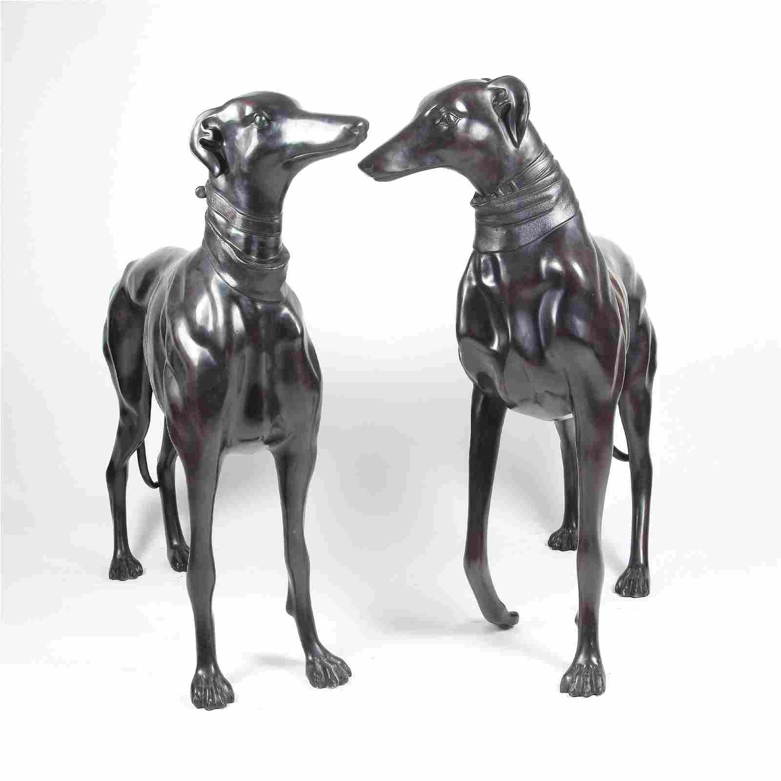 A pair of patinated bronze sculpture of a greyhound