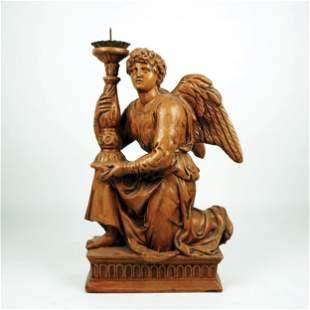 A terracotta figure of a kneeling angel
