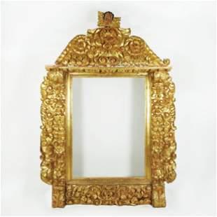 A Spanish monumantal richly carved gilt wood frame