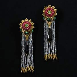 A pair of Ara earrings with colored stones, emeralds
