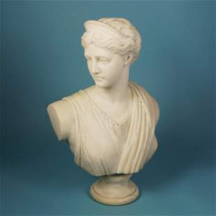 An antique white marble bust of Diana