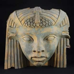 A large fiberglass head of a sphinx, '60s