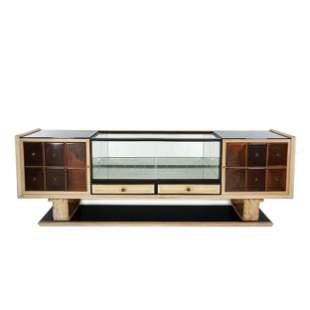 An Italian lacquered and walnut venereed sideboard