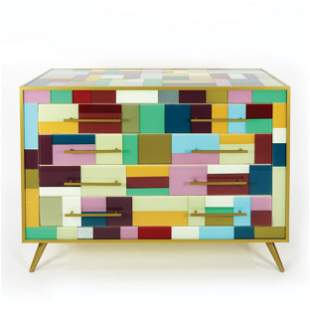 A multicolor glass covered commode with brass legs