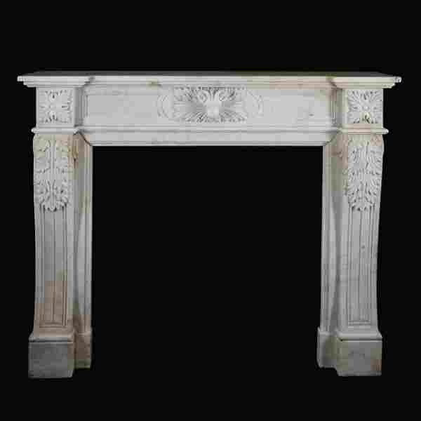 A carved white marble chimneypiece