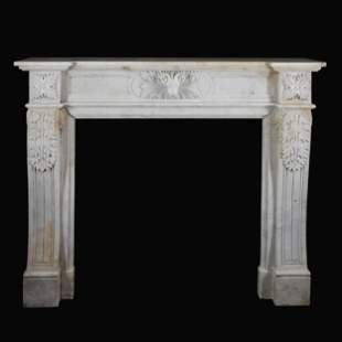 A carved white marble fireplace