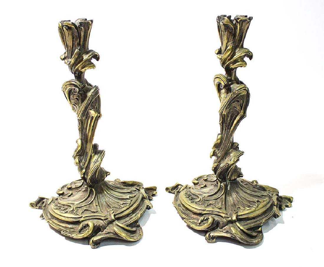 A pair of Rococo French candle sticks