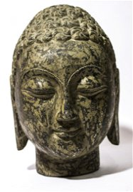 A old Buddha's head made out of basalt