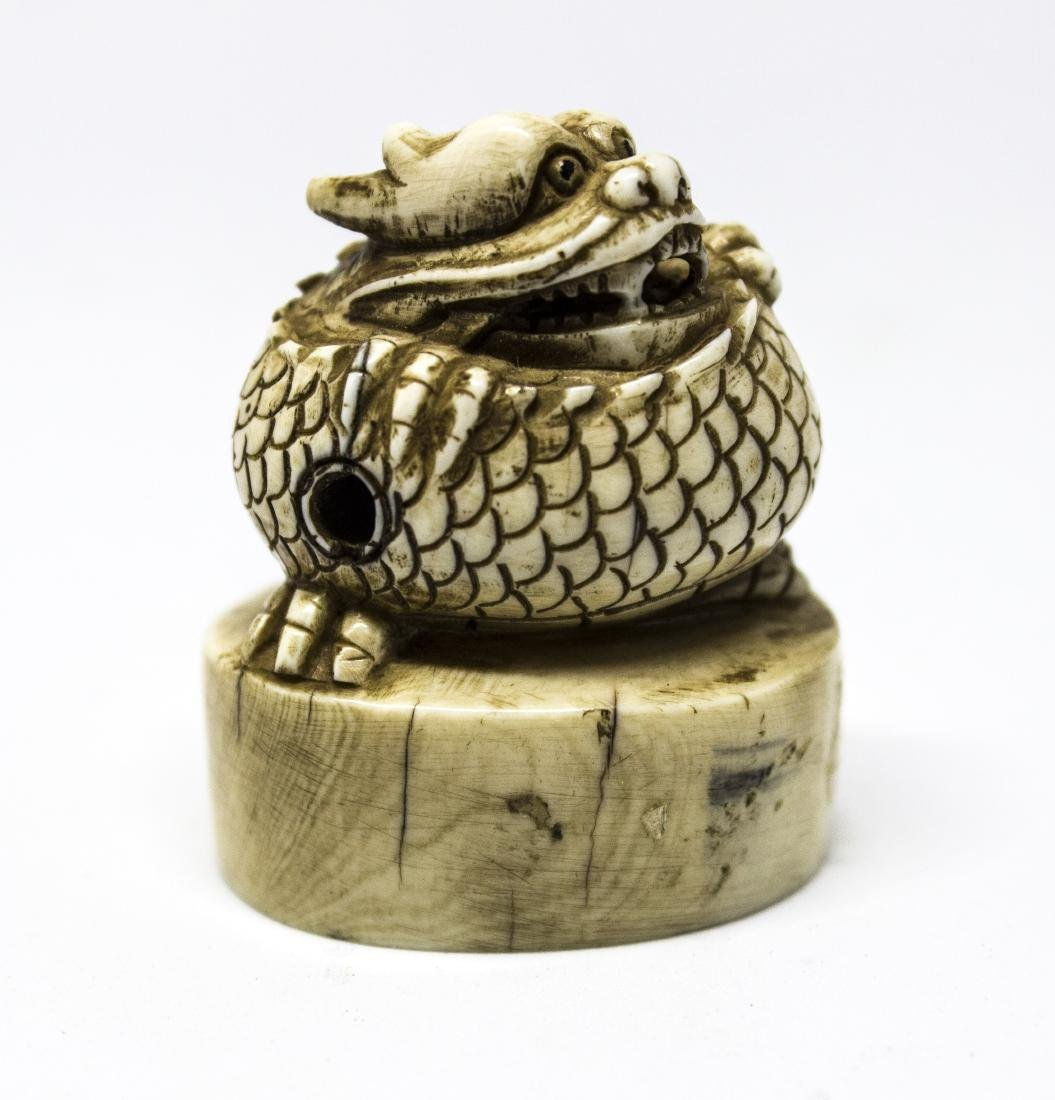 A Japanese bone Netsuke, a seal
