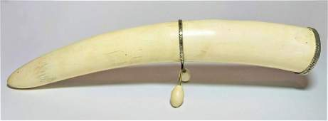 phallic bone tusk with a silver stand and lid