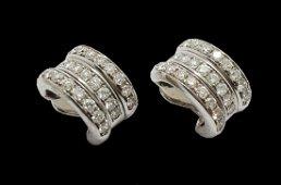 Chopard- Gold earrings set with diamonds