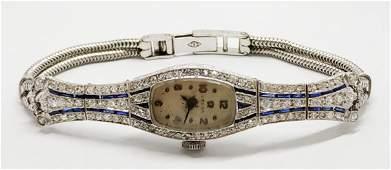 Omega - platinum art deco watch set with diamonds and