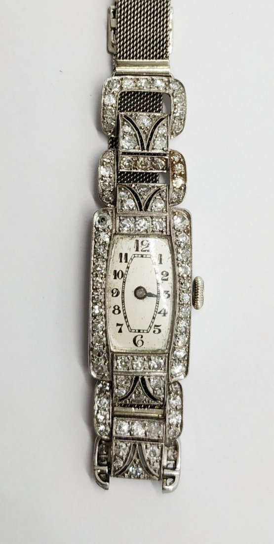 An Art Deco White Gold and Diamond Lady
