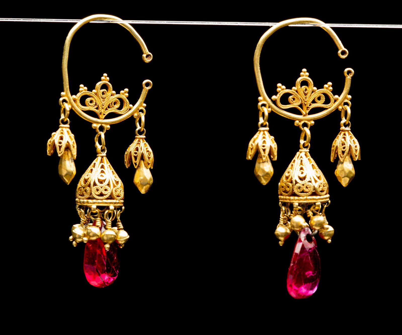 A pair of spectacular 21-22k gold and faceted red