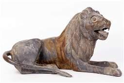 A large antique German bronze sculpture of a lounging