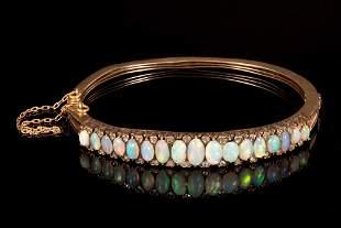 A Victorian 14K Yellow Gold, Opal and Diamond Bangle