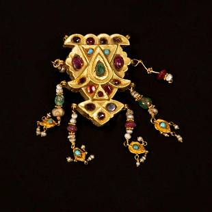 A 14K Gold Brooch / Pendant inset with various stones -
