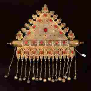 A large and impressive gilded silver and textile Tumar