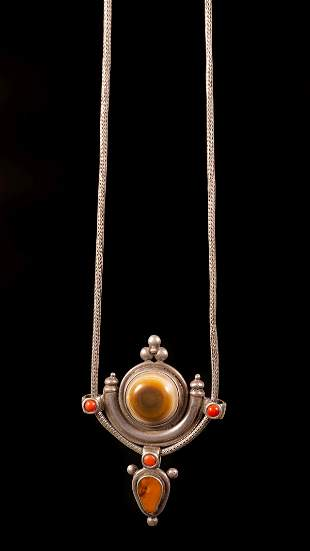 A silver Agate, amber and coral pendant - Nepal, 20th