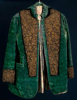 A green velvet jacket with silver embroidery and a