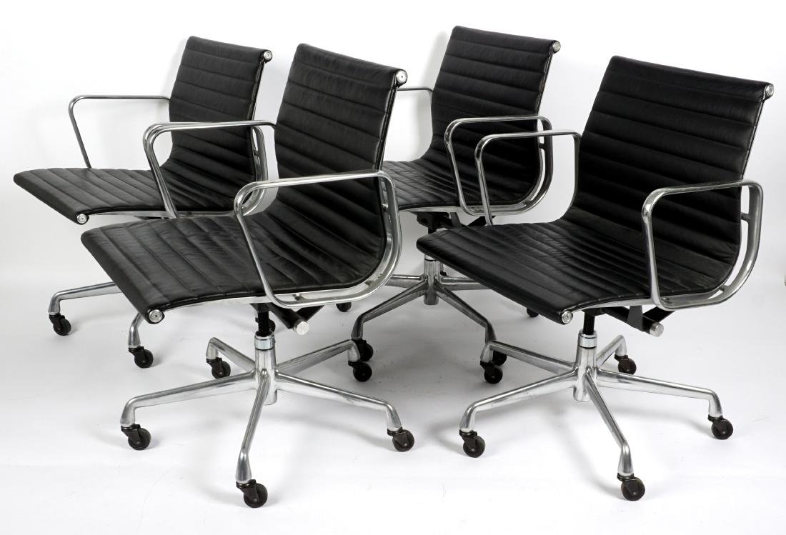 Four Eames Aluminum Group Office Chairs