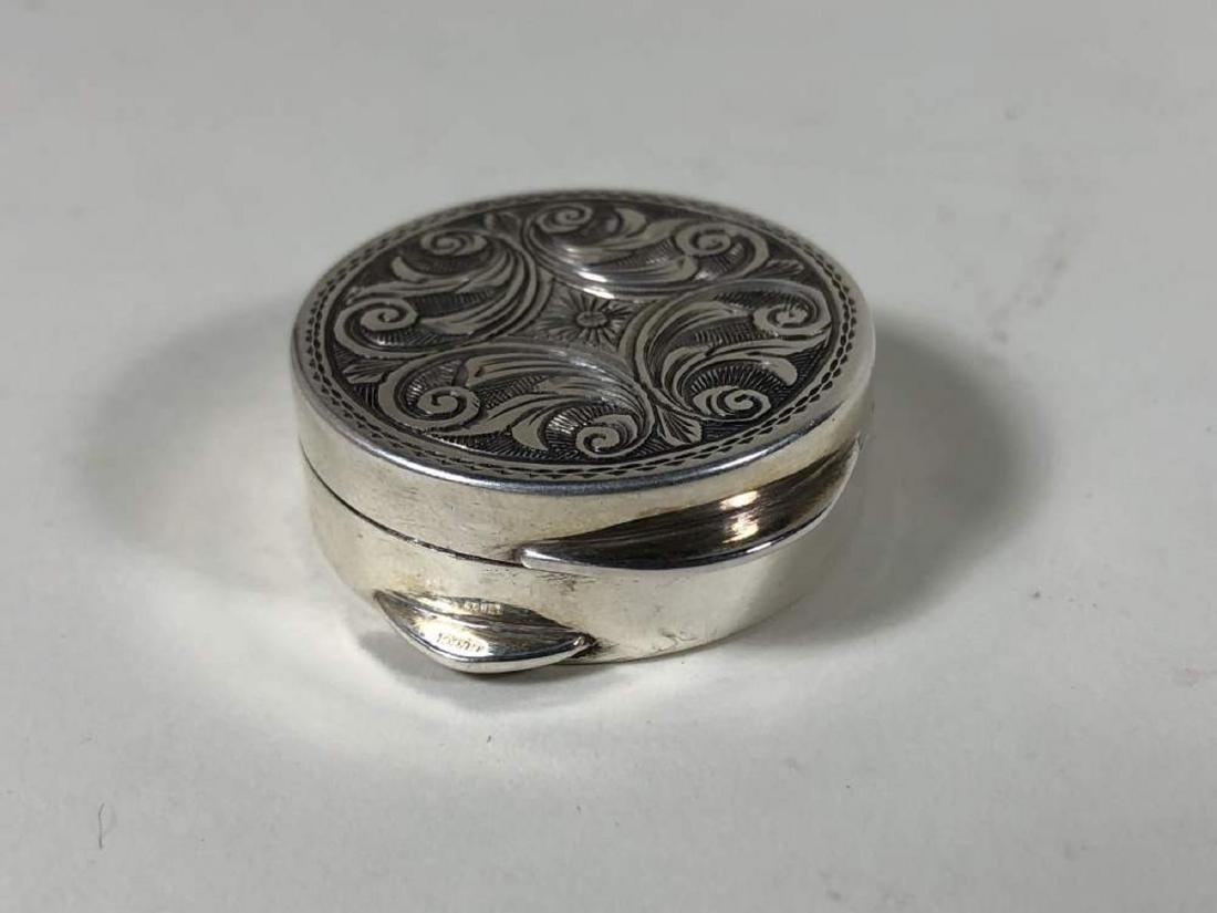 An Engraved Sterling Silver Pill Box from Gucci - 2