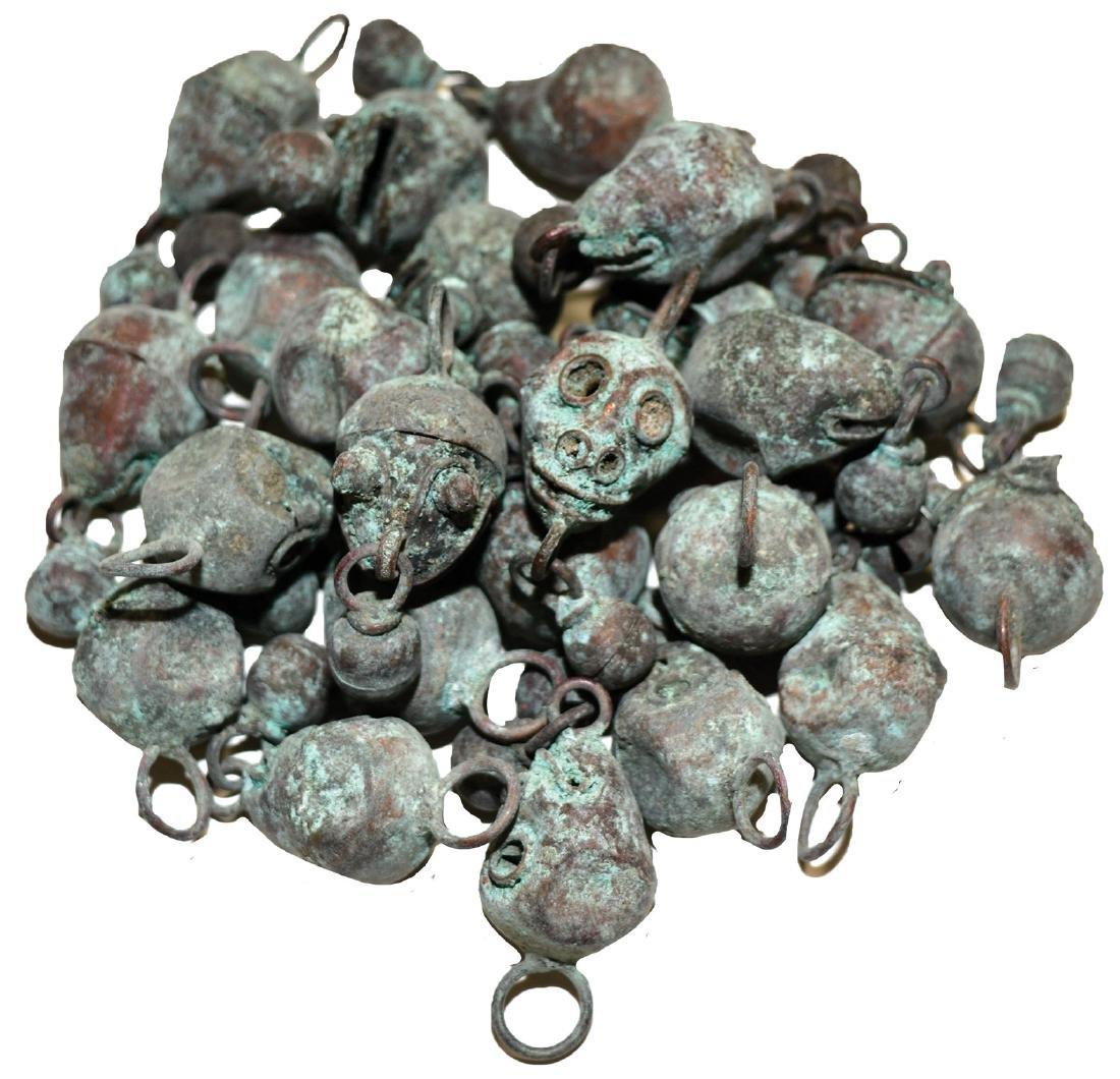 """Nineteen Copper Bells.  Monkey-like head (~1"""").  Old,"""