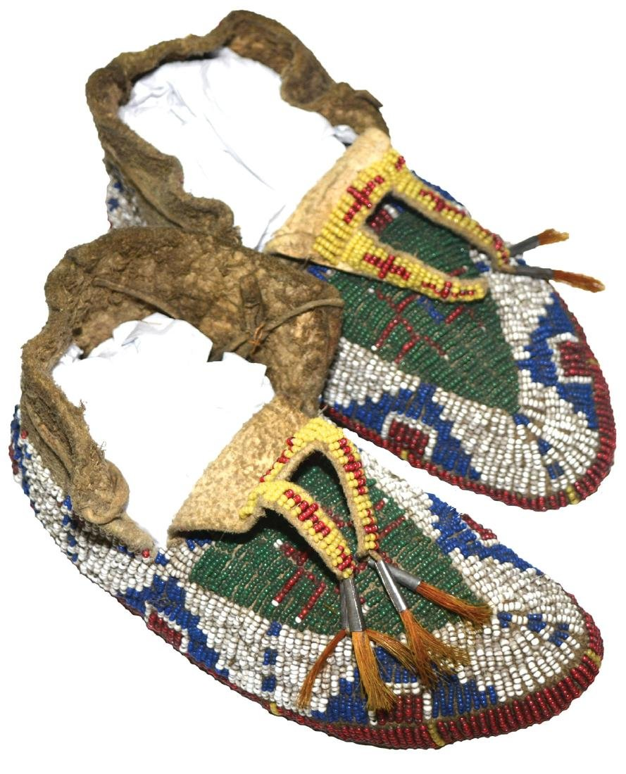 """7 3/8""""  Women's Moccasins. Fully beaded.  Earl Townsend"""
