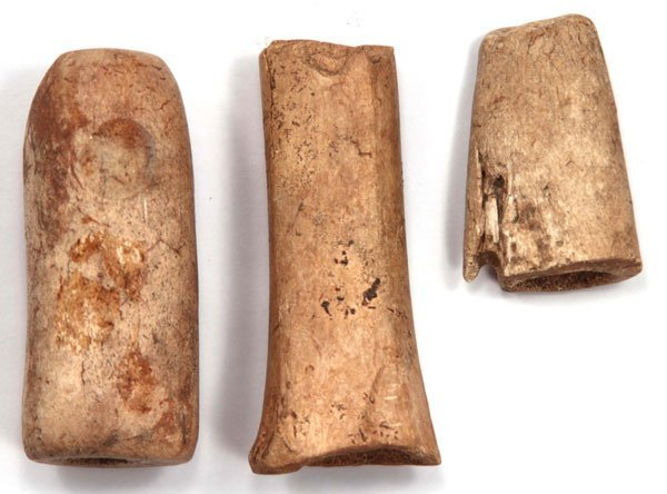 "7.  Three Drilled Bone Artifacts (largest 3"").  KY."