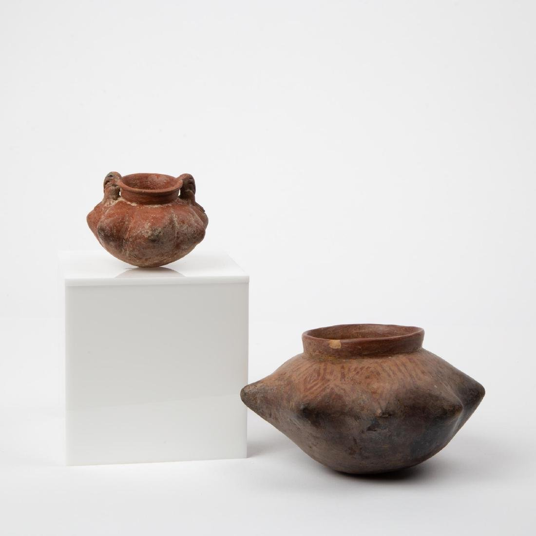 TWO UNUSUAL PRE-COLUMBIAN NARINO STAR FORM VASES