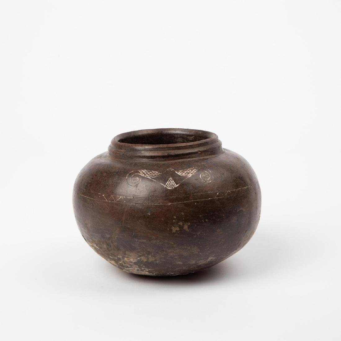 A TAIRONA INCISED BLACKWARE VESSEL WITH WHITE