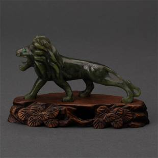 CARVED CHINESE NEPHRITE SPINACH JADE LION WITH EMERALD