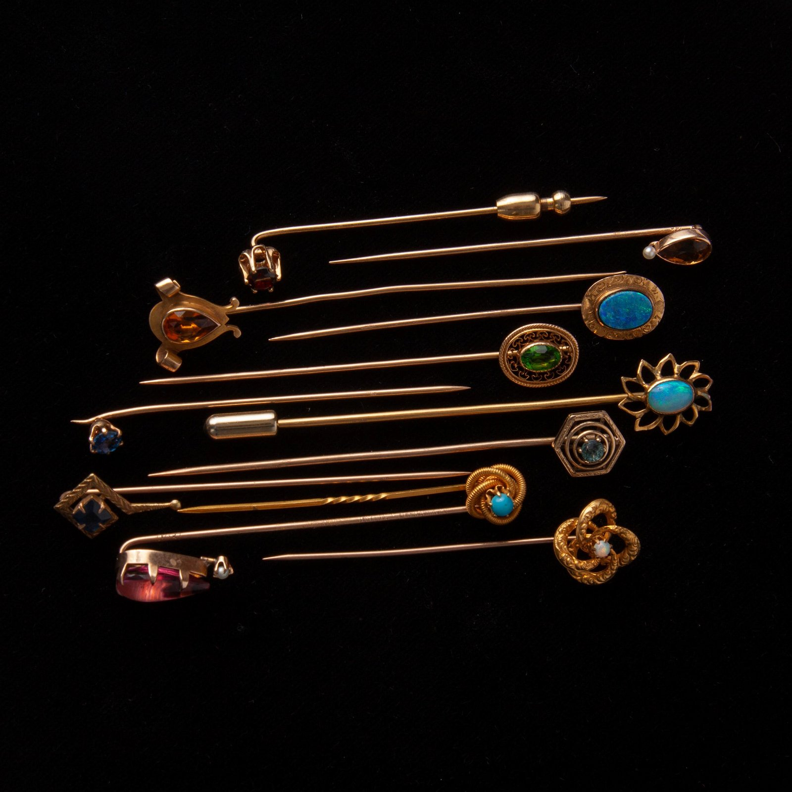 Group of 12 Gold and Gemstone Stick Pins, 10K & 14K