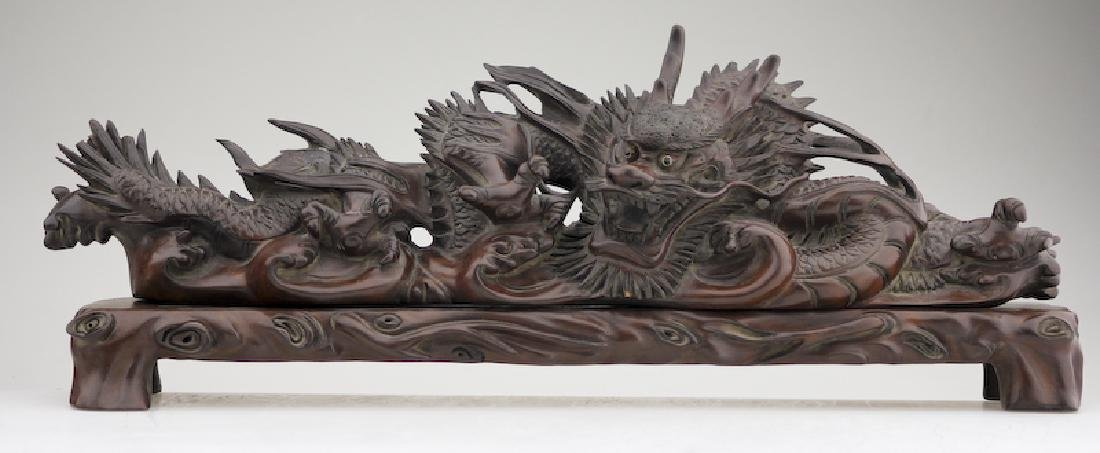 A Superb Wood Carved Dragon on a Base